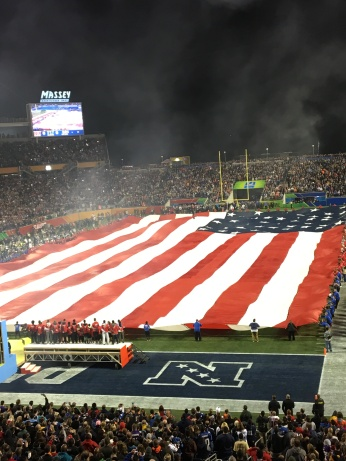 AMERICAN FLAG BEING UNFURLED AT A FOOTBALL GAME. PHOTO SENT TO ME BY MY SISTER AND HER HUSBAND.