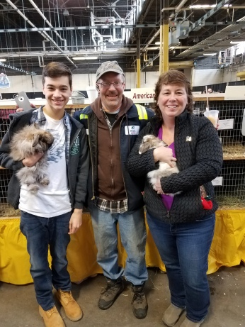 DYLAN, JEFF AND ANGELA AT THE FARM SHOW WITH THEIR SHOW RABBITS.